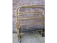 Antique brass single beds.