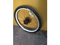 BICYCLE WHEEL 24 INCH, REAR, WITH TYRE,BRAKE DISC AND 6 SPEED COGS.