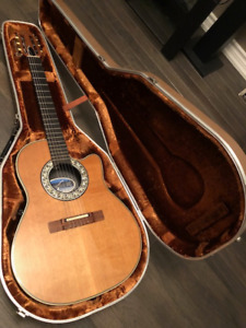 Yes it is an USA Ovation nylon... a rare find...