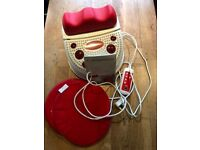 Chi machine with infrared foot massager