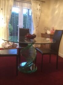 UNIQUE ROUND GLASS DINING TABLE