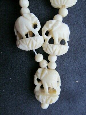 1930s Art Deco Style Jewelry Genuine Carved Elephant Beads Bovine Bone Necklace Intricate1930s 40s Vintage $26.19 AT vintagedancer.com