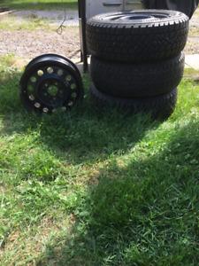 "4 - 15"" winter rims & 2 Arctic Claw snow tires."