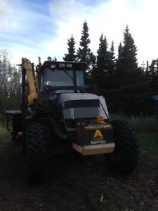 White Tractor with side boom mower