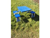 Blue folding camping table with 4 seats