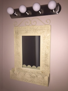 Distressed metal cream colored vanity mirror with shelf