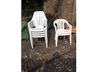 White plastic garden chairs/ 4 Highback, 2 lowback. Excellent condition.