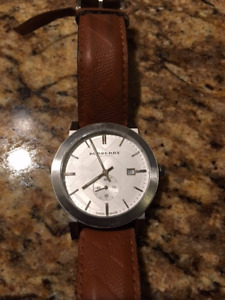 Used men's Burberry leather band watch.