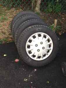 4 Michelin X-Ice 2 185 65 14 on 4 x 100 steel rims/hubcaps