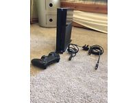 Sony PlayStation 4 - 500 GB Jet Black Console with Games and Accessories