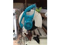 For sale a Makita heavy duty professional 110 volt tile and slab chop saw