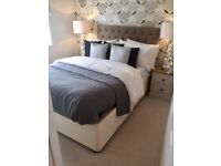 New double divan bed with padded, upholstered headboard