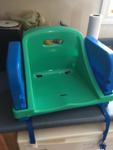Toddlers' high chair (straps onto chair)