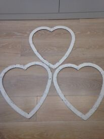 Stylish metal hearts in white
