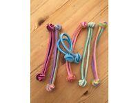 Brand new. 6 lovely coloured hair bobble type elasticated bands for hair.