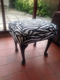Stool currently covered in zebra print