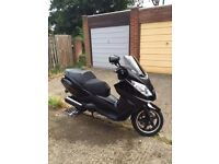 Peugeot Satellis RS Scooter, 125cc- 4v. 2010. Excellent condition.Recently registered in UK.