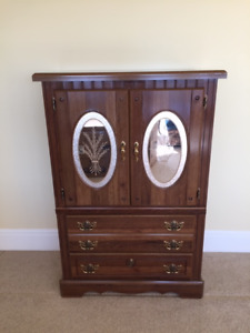 Solid wood armoire with decorative mirror inserts in doors