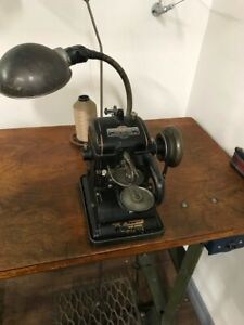 Business closing after 60 years / Antique furring machine