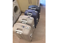 Samsonite Aeris 4 wheel hardside spinner suitcases-well travelled but complete and working