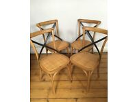 Four French bistro style dining chairs