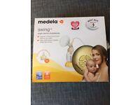 Medela swing single electric breast pump with Calma