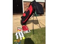 Junior clubs with golf bag on stand plus accessories