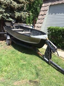 14 foot alloy fishing boat with 15 hp suzuki