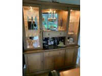 Unusual sideboard spray painted gold, three down lights behind the glass.