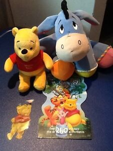 Winnie the Pooh plush toys and stickers