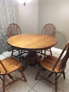 Amish solid oak table & 4 chairs $500.00