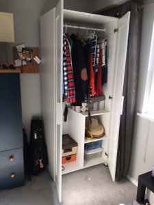 White tall IKEA wardrobe