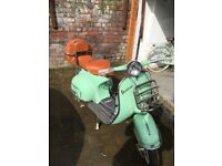 Classic 125cc Vespa, first registered in 1964