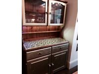 Kitchen dresser customised with gold paint, ceramic handles and mosaic tiles