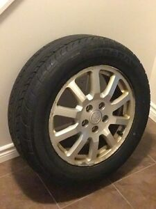 Uniroyal Tiger Paw 225/R6017 (4 tires with rims) in good shape.