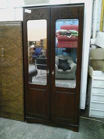 Modern wardrobe with mirrored doors