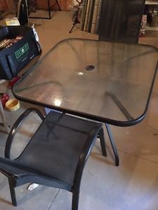 Patio table (glass) with two comfortable chairs!