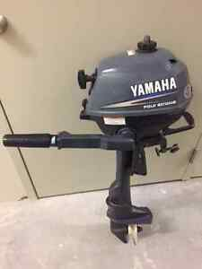 2.5 HP Yamaha 4 stroke outboard.  (like new low hours