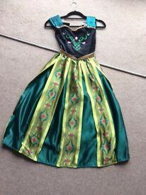 An original Disney Store Frozen Deluxe Anna Costume Dress.