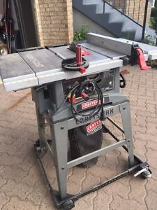 Craftsman table saw with extensions on mobile stand