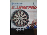 Unused Unicorn dart board with set of slightly used Puma darts.
