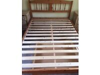 Queen size pine bed frame with matching pine storage drawer