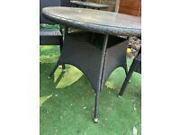 Rattan Garden table and 2 Chairs (used)