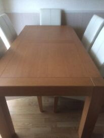 Light teak dining table and 6 chairs as new