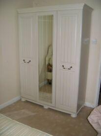 Triple wardrode with shelf space.