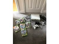 XBOX 360 WITH GAMES CONTROLLERS AND HEADSET