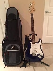 Guitar + Stand + Carrying Case + Instrument Cable