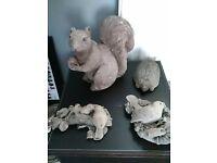 4 stone animals