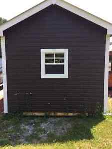 """Winter Delivery"" Canadian Built 10x14 Shed Dutch-Lap Siding"