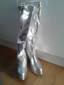 Silver knee length boots.